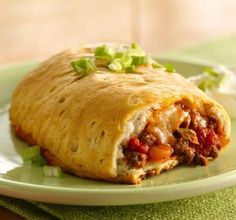 Have you tried empanadas yet? They're tasty little pockets of dough, filled with savory goodness. These ones are filled with taco beef and cheese—and they're super easy to make using Pillsbury Grands! refrigerated biscuits. Garnish with sour cream and chopped green onions to cool things down and add a pop of color.