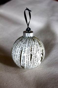 A clear glass ornament ball is tediously filled with strips of almost two pages of Jane Austen's Pride and Prejudice. Many of the strips are arranged in such a way that you can read some sentences, which is delightful indeed!