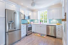 white kitchen with turquoise subway tile backsplash