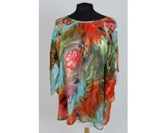 Orange print top with floaty sleeves. This top has a little lining so there's no need to put anything underneath meaning this top will be super cool!  Sizes 20-24 at ww.middletonwood.co.uk