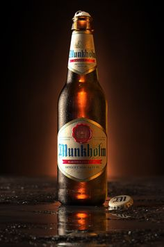 3D Munkholm Beer Bottle - Advertising Imagery by Tim Cooper - 3D Image Creation, via Behance