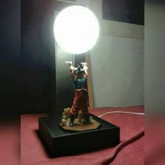 Original post (See updates at the bottom)     This is get when you use your creative genius. Combine a lamp with a Goku Dragon Ball Z action figure and you get a super badass lamp. I know where you can find the action figure