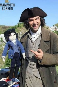 Aidan Turner -slightly creeped out that someone knitted a Poldark dolly