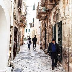 | #notmynonni  A not my nonno doing his daily walk in Polignano | #WhatItalyIs #weareinpuglia #UnaLungaVitaFelice by sherlockfall