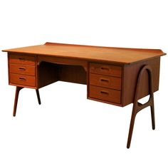 Vintage Teak Desk by Svend Madsen. 1960s, so a little late for atomic modern, but still nifty.