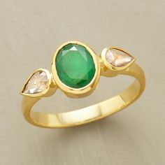 TEARDROPS EMERALD RING--In our green emerald teardrops ring, one glistening emerald radiates happiness between diamond tears of joy. Slender band rises to meet the teardrop bezels.