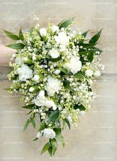 Stunning Teardrop/Cascading Wedding Bouquet Arranged With: White Lily Of The Valley, White Gypsophila (Baby's Breath), White Carnations + Green Foliage haare hochzeit wreath wedding flowers flowers summer flowers white wedding Gypsophila Bouquet, Cascading Wedding Bouquets, Cascading Flowers, Cascade Bouquet, Bride Bouquets, Bridal Flowers, Flower Bouquet Wedding, Carnation Wedding Bouquet, Bridal Bouquet White