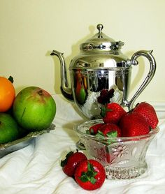 'Fruit Still Life 2' Fine Art Photography by Margaret Newcomb - Silver coffee pot, silver bowl and crystal bowl featuring fresh oranges, mangos and strawberries on white linen. #fruit #silver #crystal #coffeePot #mango #strawberries #oranges #StillLife #MargaretNewcomb #FineArt Visit my Fine Art Store to purchase Prints: http://margaret-newcomb.artistwebsites.com/art/all/all/framed+prints