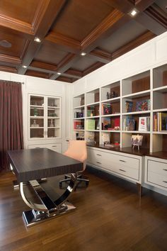 Mix of traditional wood paneled ceiling and modern home office furniture