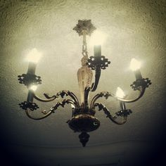 Beautiful chandelier in the apartment I was viewing.  Photo by featherstonevintage