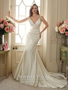 Sophia Tolli - Y11631 – Malika - Venus satin asymmetrically draped slim A-line wedding dress with embroidered slight cap sleeves, deep V-neckline, hand-beaded crystal embroidery trims sides and continues to back straps, embroidered modified keyhole back with bandeau and back zipper both feature diamante buttons, chapel length train.Sizes: 0 – 28Colors: Ivory, White