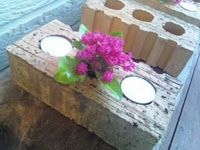 Candle holders and centerpieces -- the bricks that have holes in them are perfect for this use. You can insert a votive inside the holes (even better to have a hole big enough to fit the votive container with the votive inside for safety's sake). You can add a small plant in the middle hole.