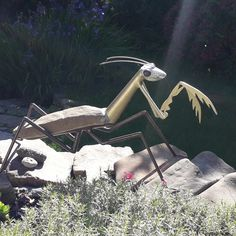 Mantis sculpture handmade out of stone and steel. Dimensions: height 42 cm, length 78 cm, width 26 cm, weight 6,5 kg.