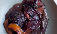 Cheek thrills: braised pig's cheeks with carrot and onions. Photograph: Jonathan Lovekin for the Observer