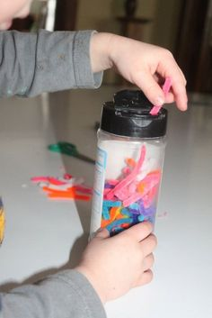 Creating sprinkles from pipe cleaners - becomes a fine motor activity!