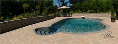 Inground Vinyl Swimming Pool- 18x31 Fiji installed in Hammonds Plains, Nova Scotia. Beautiful brown Carmel Sandstone liner. Grey steps, coping, border trend pops this pool out of its surroundings. Jet jets add a nice background noise.