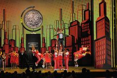 Host Neil Patrick Harris gets a lift from the cast of Bring It On: the Musical at the 2013 Tony Awards opening number.