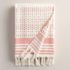 Coral stripes contrast with a sculpted ivory herringbone design on our exclusive bath towel, lending a classic vibe to your bathroom decor. Woven in Portugal of absorbent cotton, it features hand-knotted tassels along the bottom.