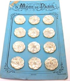 Antique French mother-of-pearl buttons on original card.