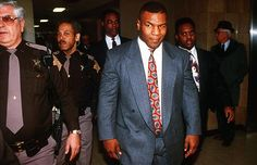 February 1992: Mike Tyson, heavyweight boxing champion leaves the Indianapolis Court House. He was found guilty on one count of rape and two counts of deviant sexual conduct for which he was sentenced to ten years in prison, suspended for four.