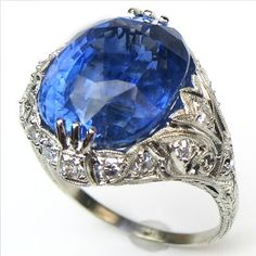 This significant ring features a fine 13.52 carat natural sapphire cradled in an Edwardian mounting with a graceful array of fine platinum tendrils and tiny antique diamonds.  Ca.1905.  Maloys.com
