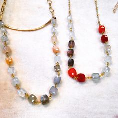 Moonstones and gold necklaces.