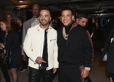 Daddy Yankee Photos - Luis Fonsi and Daddy Yankee (center) pose backstage at the 60th Annual GRAMMY Awards at Madison Square Garden on January 28, 2018 in New York City. - 60th Annual GRAMMY Awards - Backstage