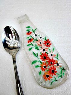 Melted bottle recycled into spoon rest and painted with glass paint.