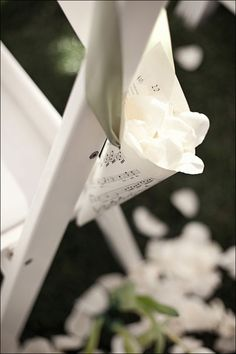 Having a rose petal toss at your wedding? Make paper cones out of sheet music and hang them on the backs of guests' chairs.