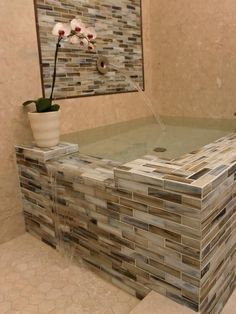Bathtub for two, overflows into the shower.