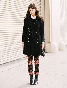 White scalloped buttonup + black sweater + long black db jacket + floral pants + patent/rubber boots