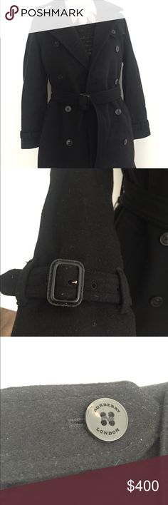 Burberry Coat Authentic Black Burberry Coat, very classy no stains, smoke free, pet free.  It's very clean it has all the bottoms.  The length of the Coat is 30 in long. I have pictures of me wearing if you want a picture comment for one. Burberry Jackets & Coats Pea Coats