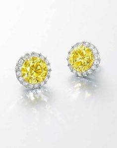 An important pair of 5.20 and 5.19 carats internally flawless and  circular-cut fancy vivid yellow diamond and
