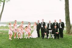 Light pink bridesmaid dresses and grey groomsmen vests