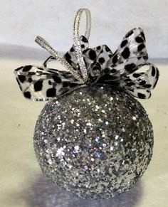 Glittered ornament with snow leopard bow