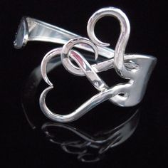 two hearts tangled together <3  ... great Valentines day gift!
