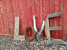 Custom-made LOVE sign/decor made from found items on our property, a little hot glue and nails for our rustic mountain wedding - DIY Rustic Wedding #kathyandryanswedding
