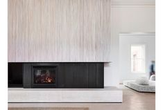 Travertine and limed white timber battens frame the fireplace at the Mornington Peninsula beach house. Beautifully captured by… Beach House Furniture, Beach House Decor, Home Decor, Beach Houses, Modern Fireplace, Fireplace Design, Timber Battens, Fireplace Surrounds, Living Spaces