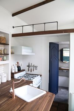 """Above the kitchen and bathroom is the 84""""x92"""" guest loft with ladder access."""