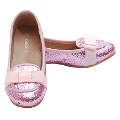 A darling dressy slip-on loafer complete with pink glitter and grosgrain bow that your little girl will love to wear. This shoe can be worn for any casual or dressy occasion! It's cute, comfortable and very stylish. The flat sole and small heel make it ea