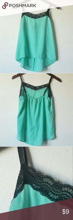 Teal black lace trim tank top Cute teal, green/blue tank top with a black lace trim and adjustable straps. No major flaws. Brand is Rue21, size M, medium. 100% polyester. Perfect shirt for the summer or a night out: pair with dark skinny jeans and a leather jacket! Rue 21 Tops Tank Tops