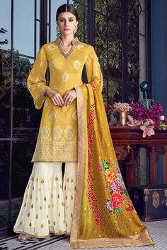 Buy Majestic Yellow Color Fancy Fabric Designer Sharara Suit your favorite adorable salwar kameez and wedding salwar kameez, and designer pakistani suits at Pakistani Designer Suits, Pakistani Suits, Pakistani Dresses, Punjabi Suits, Pakistani Sharara, Shadi Dresses, Eid Dresses, Pakistani Bridal, Long Dresses
