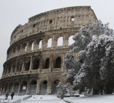 Desolate grace: The capital's iconic Colosseum has not been snowed upon in nearly three decades