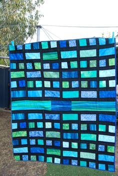 My completed cot size batik quilt