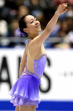 Mao Asada of Japan competes in the Ladies' Short Program during day one of the ISU Grand Prix of Figure Skating 2013/2014 NHK Trophy at Yoyogi National Gymnasium on November 8, 2013 in Tokyo, Japan.