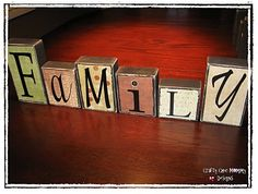 Easy craft w/ 2x4's, scrap book paper, and Vinyl Block Letters