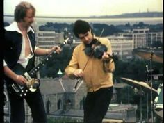 Horslips playing King of the Fairies on the top of the Bank of Ireland on Baggot Street, Dublin in 1973 - trad-folk-70s-prog-rock, love it!