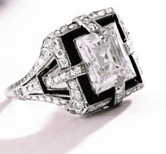 Lot 221 - Platinum, Diamond and Onyx Ring, Tiffany & Co., Circa 1925