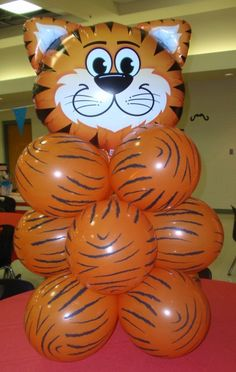 I have done this with ghost and bat balloons for Halloween party centerpieces. Kids LOVE it and it is festive, but not excessive
