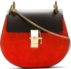 """Structured buffed leather bag in black. Gold-tone hardware. Contrasting suede panel at front in vermillion red. Curb chain shoulder strap. Foldover flap at main compartment with post and chain-lock closure. Vermillion and brown suede interior. Patch pocket at interior. Tonal stitching. Approx. 9"""" length, 7"""" height, 3"""" width."""